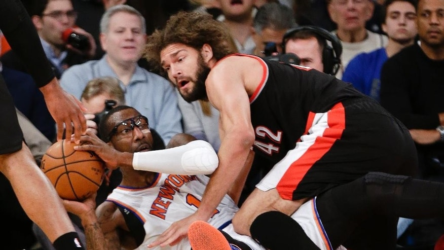 New York Knicks' Amar'e Stoudemire (1) and Portland Trail Blazers' Robin Lopez (42) fight for control of the ball during the first half of an NBA basketball game Sunday, Dec. 7, 2014, in New York.  (AP Photo/Frank Franklin II)