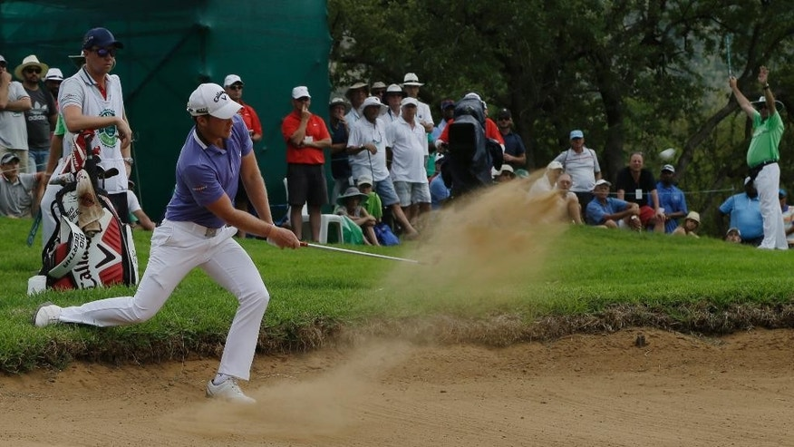 Danny Willett of England, plays a shot out of a bunker on the 13th hole, during the Nedbank Golf Challenge at the Gary Player Country Club in Sun City, South Africa, Sunday Dec. 7, 2014. (AP Photo/Themba Hadebe)