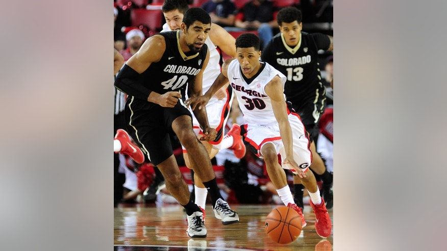 Georgia guard J.J. Frazier (30) gets to a loose ball before Colorado forward Josh Scott (40) during the first half of an NCAA college basketball game Sunday, Dec. 7, 2014, in Athens, Ga.  (AP Photo/The Banner-Herald, Richard Hamm) MAGS OUT; MANDATORY CREDIT