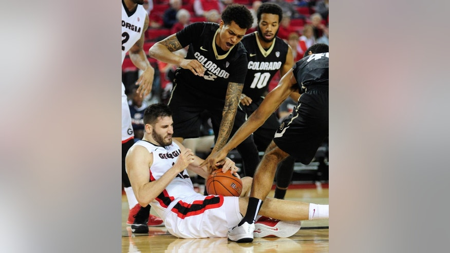 Georgia forward Nemanja Djurisic (42) tries to maintain possession as Colorado guard/forward Dustin Thomas (13) and Colorado forward Josh Scott (40) try for a steal during the first half of an NCAA college basketball game Sunday, Dec. 7, 2014, in Athens, Ga.   (AP Photo/The Banner-Herald, Richard Hamm) MAGS OUT; MANDATORY CREDIT