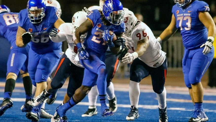 Boise State running back Jay Ajayi (27) runs the ball during the first half of the Mountain West Conference championship NCAA college football game against Fresno State in Boise, Idaho, on Saturday, Dec. 6, 2014. (AP Photo/Otto Kitsinger)