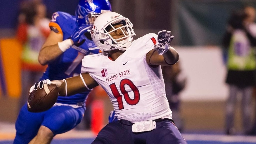 Fresno State wide receiver Greg Watson (10) prepares for a long pass during the first play of the first half of the Mountain West Conference championship NCAA college football game in Boise, Idaho, on Saturday, Dec. 6, 2014. (AP Photo/Otto Kitsinger)
