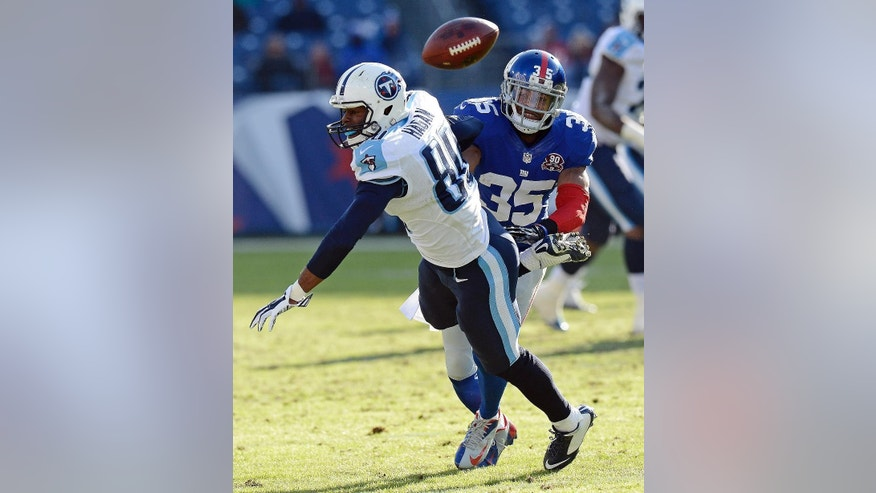 New York Giants free safety Quintin Demps (35) breaks up a pass intended for Tennessee Titans wide receiver Derek Hagan (80) in the second half of an NFL football game Sunday, Dec. 7, 2014, in Nashville, Tenn. (AP Photo/Mark Zaleski)