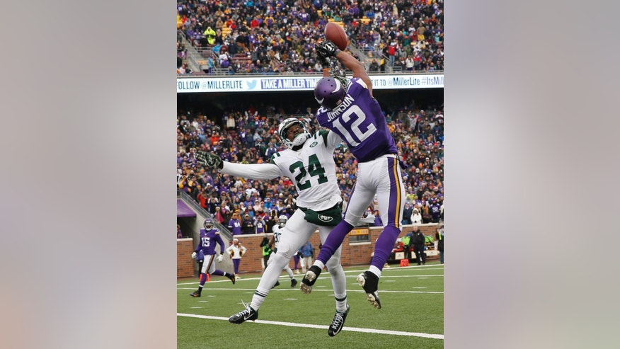 New York Jets cornerback Phillip Adams, left, breaks up a pass in the end zone intended for Minnesota Vikings wide receiver Charles Johnson (12) during the second half of an NFL football game, Sunday, Dec. 7, 2014, in Minneapolis. (AP Photo/Alex Brandon)