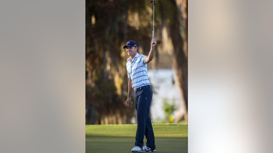 Jordan Spieth celebrates his birdie on the 18th hole during the third round of the Hero World Challenge golf tournament on Saturday, Dec. 6, 2014, in Windermere, Fla. (AP Photo/Willie J. Allen Jr.)