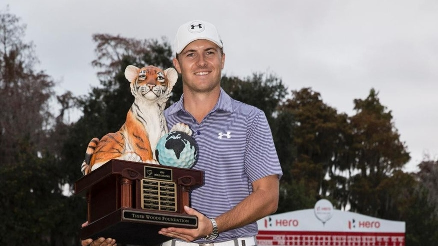 Jordan Spieth holds the championship trophy after winning the Hero World Challenge golf tournament on Sunday, Dec. 7, 2014, in Windermere, Fla. (AP Photo/Willie J. Allen Jr.)