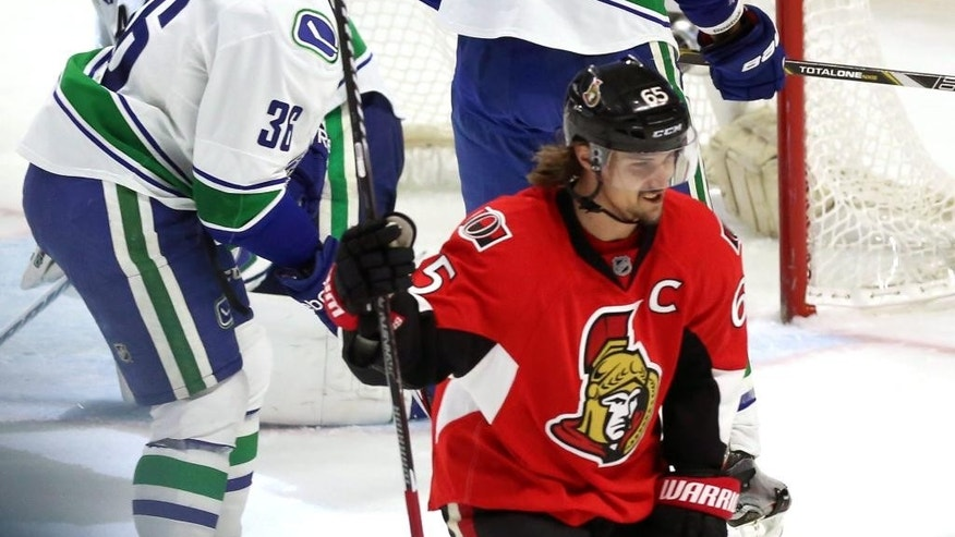 Ottawa Senators' Erik Karlsson (65) celebrates his winning goal against the Vancouver Canucks during an NHL hockey game in Ottawa, Ontario, Sunday, Dec. 7, 2014. (AP Photo/The Canadian Press, Fred Chartrand)