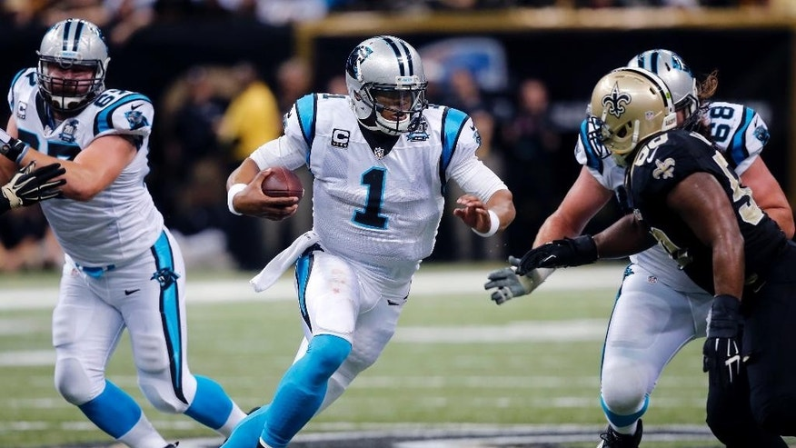 Carolina Panthers quarterback Cam Newton (1) carries in the first half of an NFL football game against the New Orleans Saints in New Orleans, Sunday, Dec. 7, 2014. (AP Photo/Bill Haber)