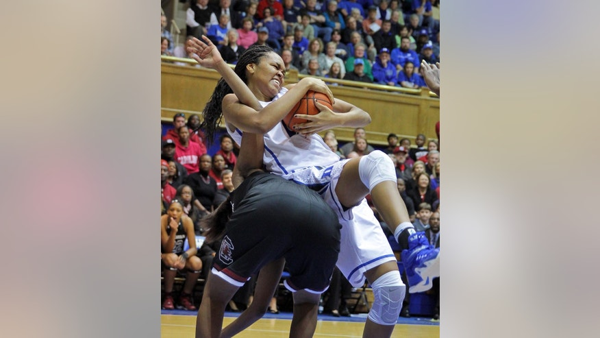 Duke's Azura Stevens grabs a rebound from South Carolina's Tina Roy during an NCAA college basketball game in Durham, N.C., Sunday, Dec. 7, 2014.  (AP Photo/Ted Richardson)