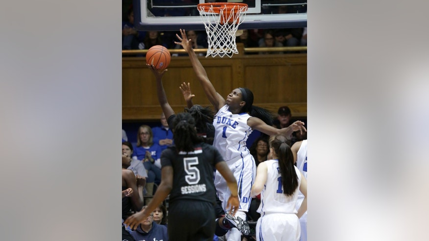 Duke's Elizabeth Williams defends against a shot by South Carolina's Aleighsa Welch during an NCAA college basketball game in Durham, N.C., Sunday, Dec. 7, 2014. (AP Photo/Ted Richardson)