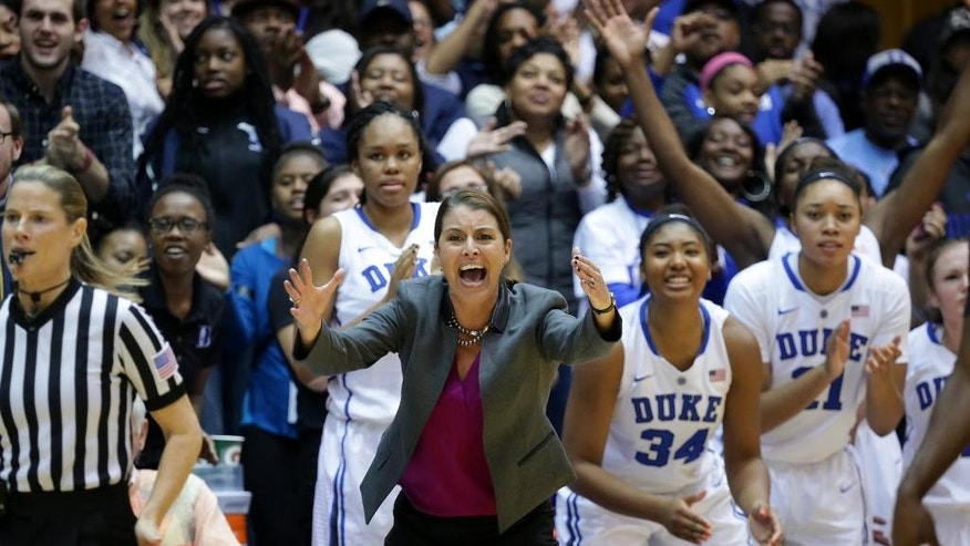 Duke head women's basketball coach Joanne P. McCallie, center, yells from the sideline during a 51-50 loss to South Carolina in an NCAA college basketball game in Durham, N.C., Sunday, Dec. 7, 2014. (AP Photo/Ted Richardson)
