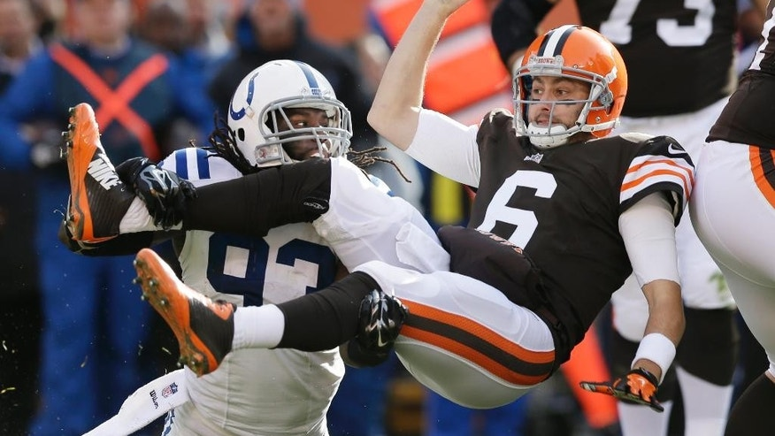 Cleveland Browns quarterback Brian Hoyer (6) is sacked by Indianapolis Colts outside linebacker Erik Walden (93) in the first quarter of an NFL football game Sunday, Dec. 7, 2014, in Cleveland. (AP Photo/Tony Dejak)