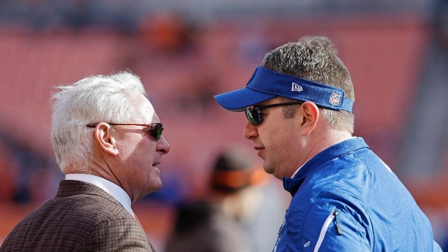 Cleveland Browns owner Jimmy Haslam, left, talks with former Browns coach Rob Chudzinski, now an Indianapolis Colts special assistant, before an NFL football game Sunday, Dec. 7, 2014, in Cleveland. (AP Photo/Tony Dejak)
