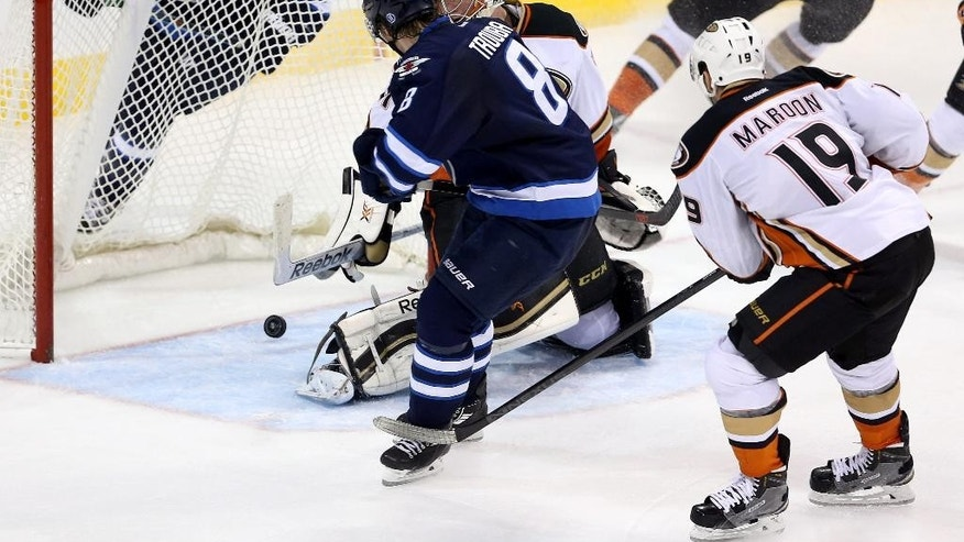 Winnipeg Jets' Jacob Trouba (8) beats Anaheim Ducks goaltender Frederik Anderson (31) late in the third period of an NHL hockey game in Winnipeg, Sunday, Dec. 7, 2014. (AP Photo/The Canadian Press, Trevor Hagan)