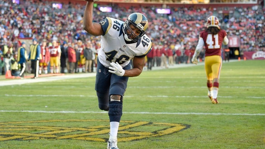 St. Louis Rams tight end Cory Harkey (46) celebrates his two point convention during the second half of an NFL football game against the Washington Redskins in Landover, Md., Sunday, Dec. 7, 2014. (AP Photo/Nick Wass)