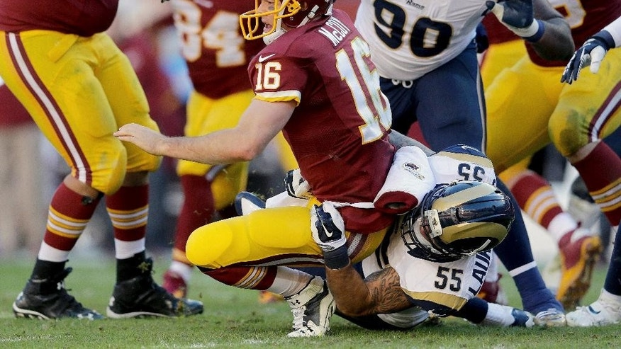 Washington Redskins quarterback Colt McCoy (16) is sacked by St. Louis Rams middle linebacker James Laurinaitis (55) during the first half of an NFL football game in Landover, Md., Sunday, Dec. 7, 2014. (AP Photo/Patrick Semansky)