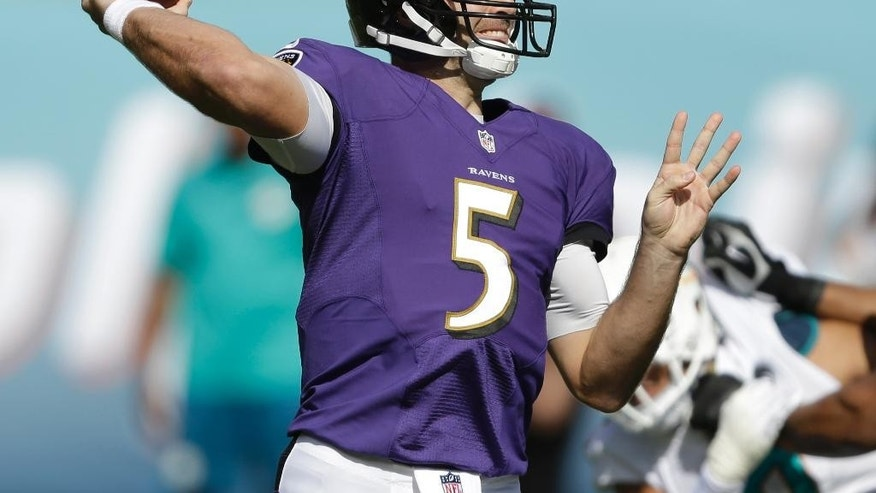 Baltimore Ravens quarterback Joe Flacco (5) looks to pass during the first half of an NFL football game against the Miami Dolphins, Sunday, Dec. 7, 2014, in Miami Gardens, Fla. (AP Photo/Wilfredo Lee)