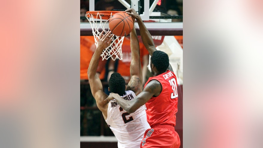 Radford's Jalen Carethers (30) blocks a shot by Virginia Tech's Joey van Zegeren (2) in the first half of  an NCAA college basketball game in Blacksburg, Va., Sunday, Dec. 7, 2014. (AP Photo / The Roanoke Times, Matt Gentry)  LOCAL STATIONS OUT; LOCAL INTERNET OUT; LOCAL PRINT OUT (SALEM TIMES REGISTER; FINCASTLE HERALD; CHRISTIANSBURG NEWS MESSENGER; RADFORD NEWS JOURNAL; ROANOKE STAR SENTINEL