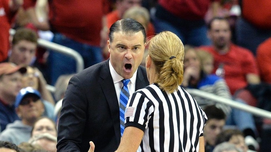 Kentucky head coach Matthew Mitchell, left, argues with official Dee Kantner during the second half of an NCAA college basketball game against Louisville, Sunday, Dec. 7, 2014, in Louisville, Ky. Kentucky won 77-68. (AP Photo/Timothy D. Easley)