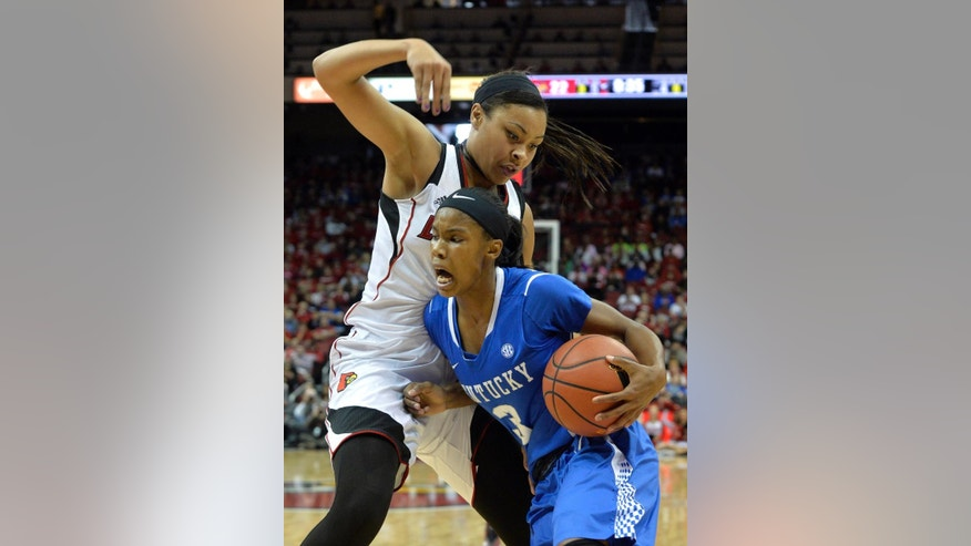 Kentucky's Janee Thompson, right, attempts to drive past the defense of Louisville's Mariya Moore during the first half of an NCAA college basketball game Sunday, Dec. 7, 2014, in Louisville, Ky. (AP Photo/Timothy D. Easley)