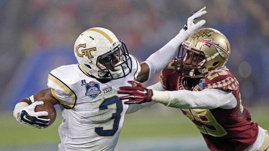 Georgia Tech running back Dennis Andrews (3) tries to break the tackle of Florida State defensive back Nate Andrews (29) during the first half of the Atlantic Coast Conference championship NCAA college football game in Charlotte, N.C., Saturday, Dec. 6, 2014. (AP Photo/Chuck Burton)