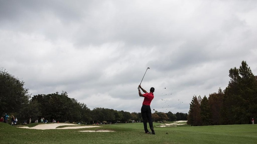Tiger Woods chips the ball down the fairway during the final round of the Hero World Challenge golf tournament on Sunday, Dec. 7, 2014, in Windermere, Fla. (AP Photo/Willie J. Allen Jr.)