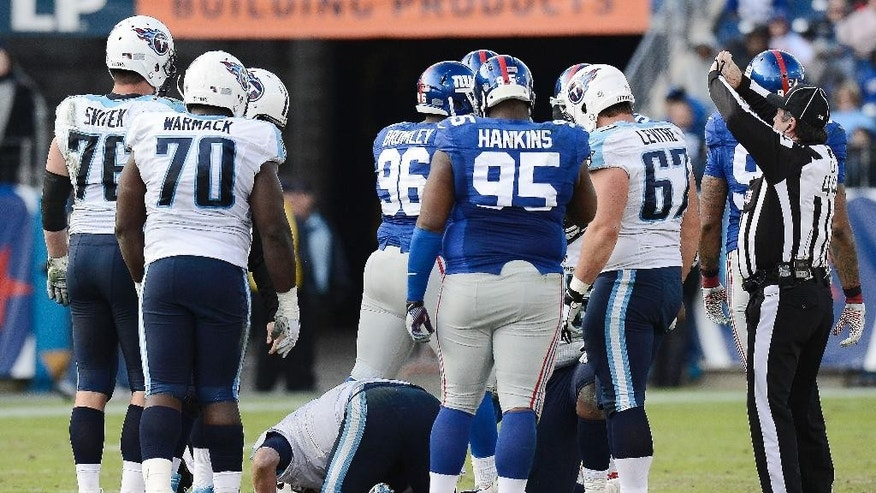 Tennessee Titans quarterback Zach Mettenberger kneels on the field after being injured in the second half of an NFL football game against the New York Giants Sunday, Dec. 7, 2014, in Nashville, Tenn. (AP Photo/Mark Zaleski)