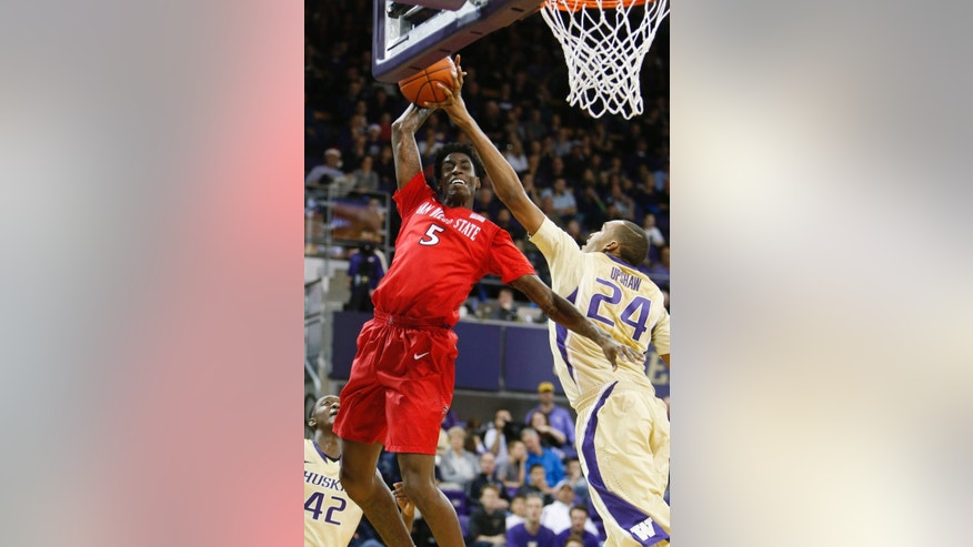 San Diego State forward Dwayne Polee II (5) gets his attempted dunk blocked by Washington center Robert Upshaw (24) in the second half of an NCAA college basketball game, Sunday, Dec. 7, 2014, in Seattle. Washington won 49-36. (AP Photo/Jennifer Buchanan)