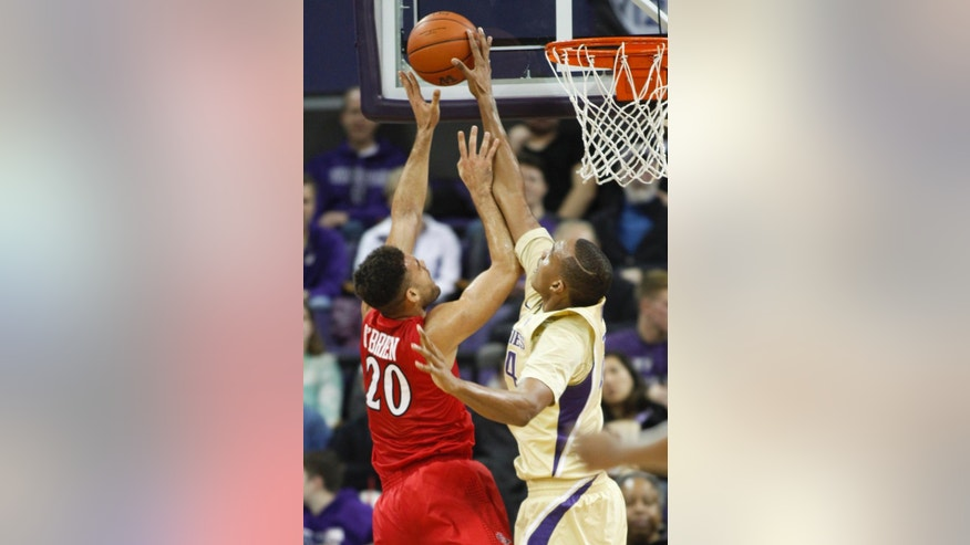 Washington center Robert Upshaw, right, blocks a shot by San Diego State forward JJ O'Brien (20) in the first half of an NCAA college basketball game, Sunday, Dec. 7, 2014, in Seattle, Wash. (AP Photo/Jennifer Buchanan)