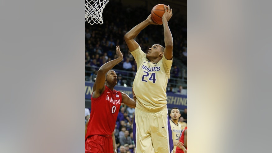 Washington center Robert Upshaw (24) puts up a shot against San Diego State forward Skylar Spencer (0) in the first half of an NCAA college basketball game, Sunday, Dec. 7, 2014, in Seattle, Wash. (AP Photo/Jennifer Buchanan)