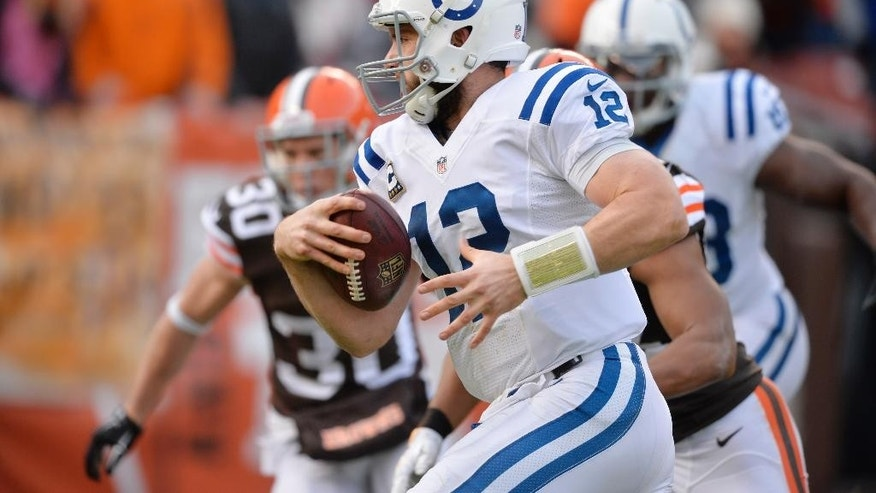 Indianapolis Colts quarterback Andrew Luck runs for a touchdown against the Cleveland Browns in the second quarter of an NFL football game Sunday, Dec. 7, 2014, in Cleveland. (AP Photo/David Richard)
