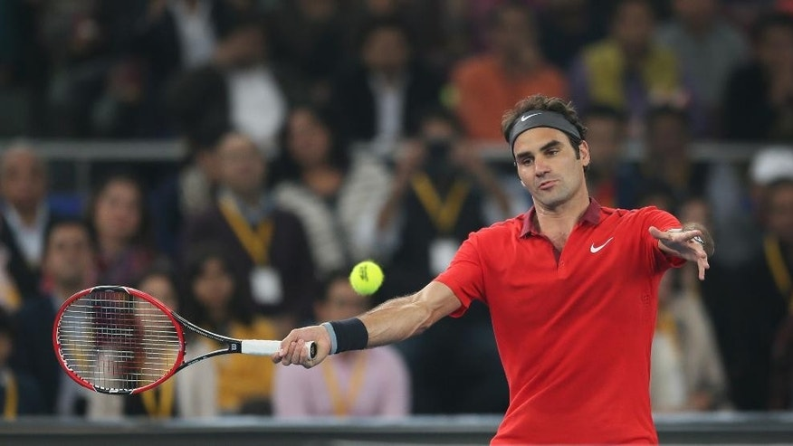 Micromax Indian Aces player Roger Federer, plays against Musafir.com UAE Royals Novak Djokovic during International Premier Tennis League, in New Delhi, India, Monday, Dec. 8, 2014. (AP Photo/Manish Swarup)