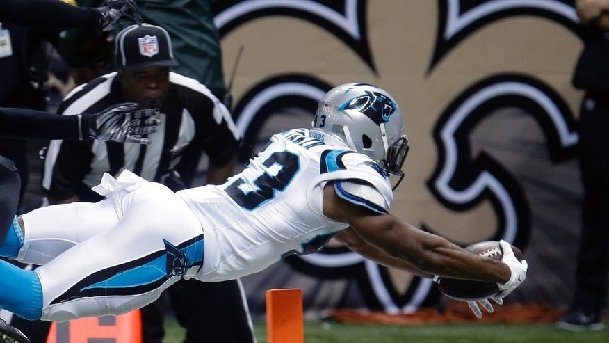 Carolina Panthers running back Fozzy Whittaker (43) dives for a touchdown in the second half of an NFL football game against the New Orleans Saints in New Orleans, Sunday, Dec. 7, 2014. (AP Photo/Bill Feig)