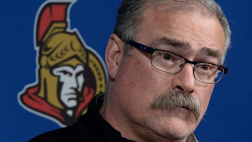 FILE - This is an April 14, 2014, file photo showing Ottawa Senators' head coach Paul MacLean during a press conference in Ottawa. The Senators have fired coach MacLean, Monday, Dec. 8, 2014,  after an 11-11-5 start _ the first coaching dismissal in the NHL this season. (AP Photo/The Canadian Press, Sean Kilpatrick)