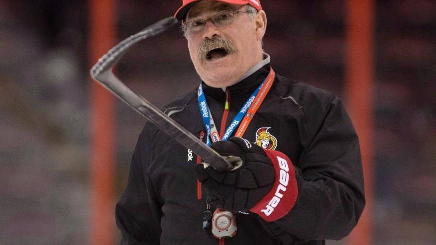 FILE - This is an April 30, 2013, file photo showing Ottawa Senators head coach Paul MacLean instructing players during practice in Ottawa. The Senators have fired coach MacLean, Monday, Dec. 8, 2014,  after an 11-11-5 start _ the first coaching dismissal in the NHL this season.(AP Photo/The Canadian Press, Adrian Wyld)