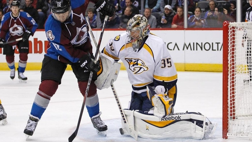 Nashville Predators goalie Pekka Rinne (35) blocks a shot by Colorado Avalanche right wing Jarome Iginla (12) during the first period of an NHL hockey game Tuesday, Dec. 9, 2014, in Denver. (AP Photo/Jack Dempsey)