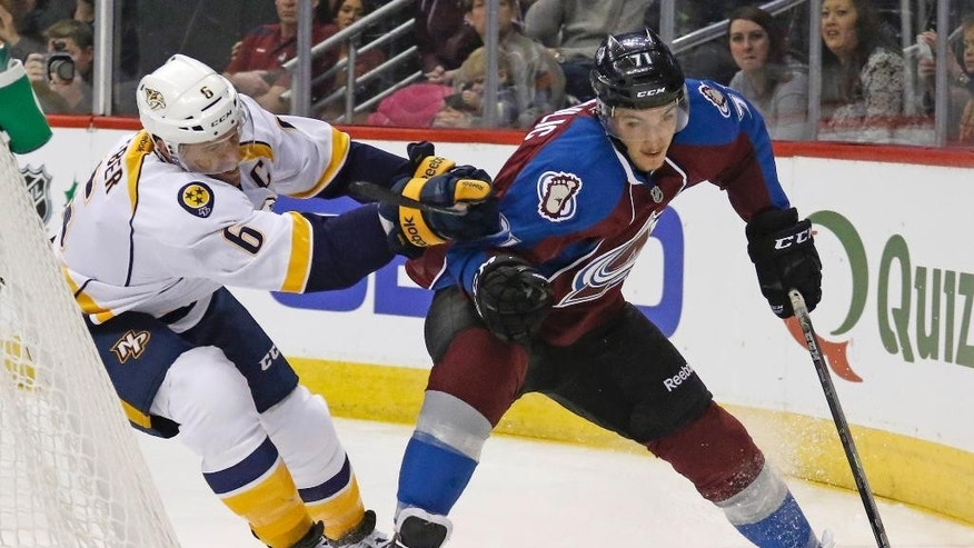 Nashville Predators defenseman Shea Weber (6) pushes Colorado Avalanche's Borna Rendulic (71) during the first period of an NHL hockey game Tuesday, Dec. 9, 2014, in Denver. (AP Photo/Jack Dempsey)