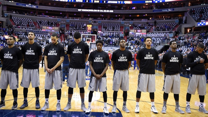 "Dec. 10, 2014: Members of the Georgetown basketball team stand for the National Anthem wearing ""I Can't Breathe"" t-shirts before an NCAA college basketball game against Kansas,"