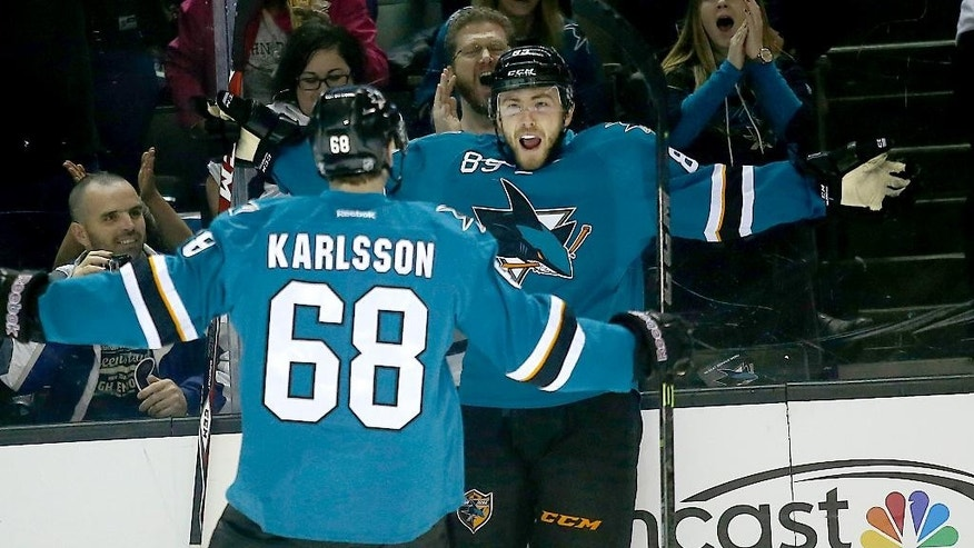 San Jose Sharks left wing Barclay Goodrow (89) celebrates with teammate Melker Karlsson (68) after scoring a goal against the Edmonton Oilers during the first period of an NHL hockey game Tuesday, Dec. 9, 2014, in San Jose, Calif. (AP Photo/Tony Avelar)