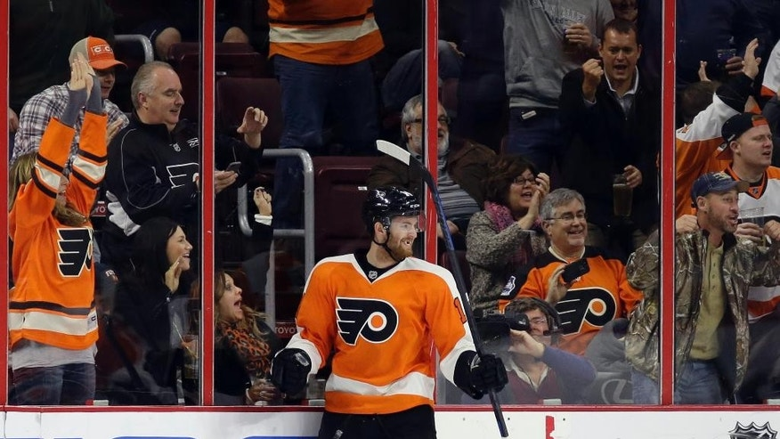 Philadelphia Flyers' Sean Couturier celebrates after scoring a goal during the first period of an NHL hockey game against the New Jersey Devils, Thursday, Dec. 11, 2014, in Philadelphia. (AP Photo/Matt Slocum)