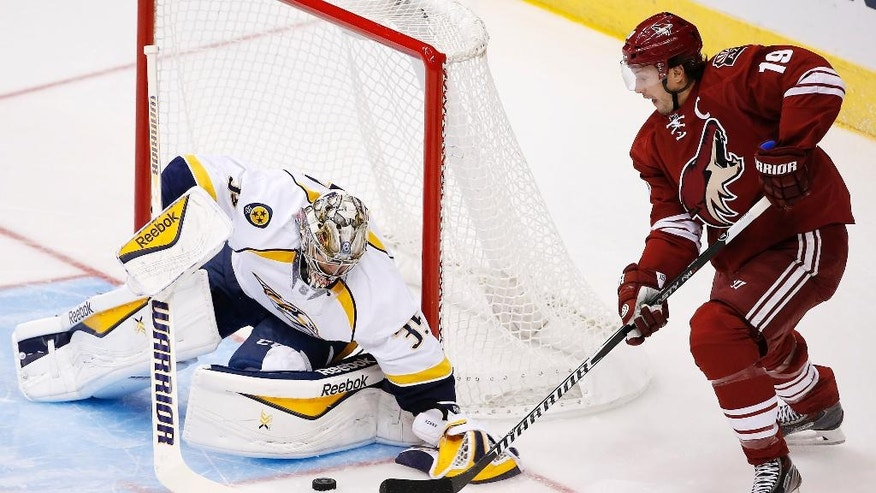 Nashville Predators' Pekka Rinne (35), of Finland, makes a save on a shot by Arizona Coyotes' Shane Doan (19) during the first period of an NHL hockey game Thursday, Dec. 11, 2014, in Glendale, Ariz. (AP Photo/Ross D. Franklin)