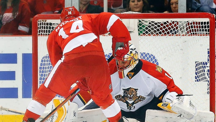 Florida Panthers goalie Roberto Luongo (1) stops a Detroit Red Wings center Gustav Nyquist (14) shot during a shootout in an NHL hockey game in Detroit Friday, Dec. 12, 2014. (AP Photo/Paul Sancya)