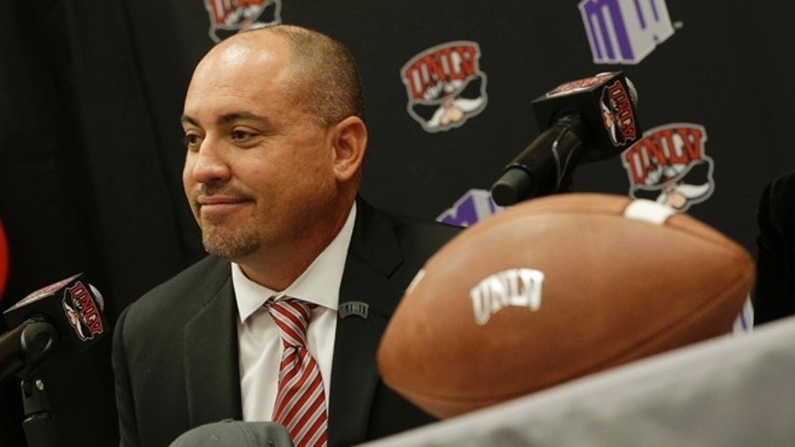 Tony Sanchez speaks at a news conference at the University of Las Vegas, Nevada Thursday, Dec. 11, 2014, in Las Vegas. Sanchez, former head coach of Bishop Gorman High School, has been chosen to be the new head football coach for UNLV. The hire is pending approval by the Board of Regents. (AP Photo/John Locher)