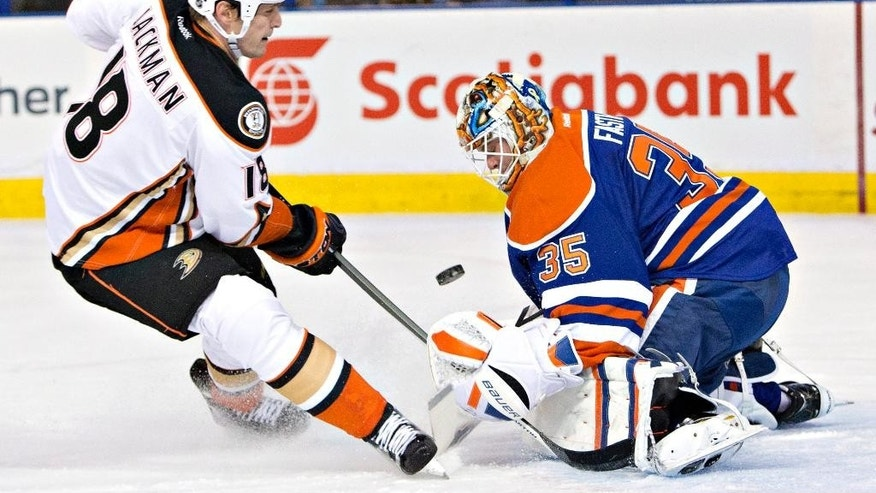 Anaheim Ducks' Tim Jackman (18) is stopped by Edmonton Oilers goalie Viktor Fasth (35) during the first period of their NHL hockey game in Edmonton, Alberta, Canada on Friday, Dec. 12, 2014. (AP Photo/The Canadian Press, Jason Franson)