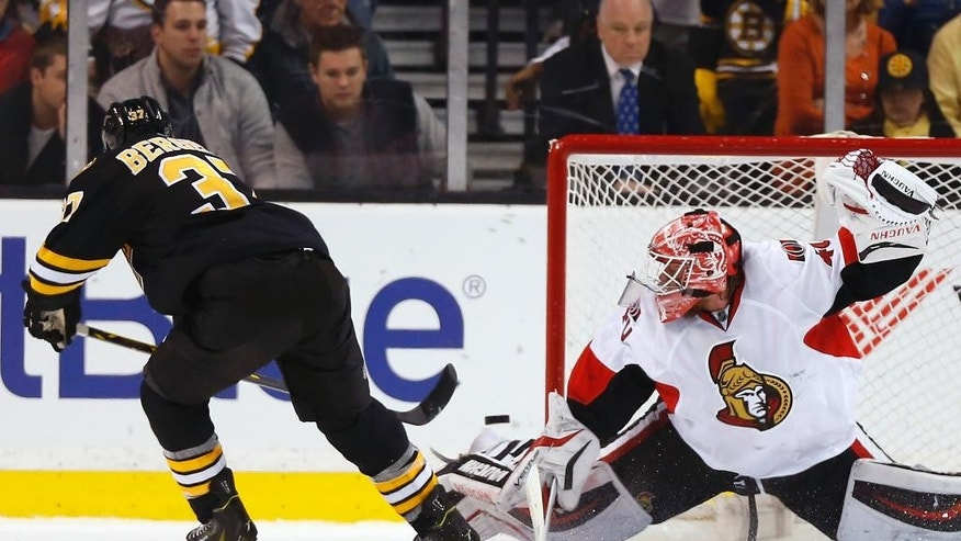 Boston Bruins' Patrice Bergeron is stopped during the shootout by Ottawa Senators goalie Robin Lehner in the Senators 3-2 win in a shootout in an NHL hockey game in Boston Saturday, Dec. 13, 2014. (AP Photo/Winslow Townson)