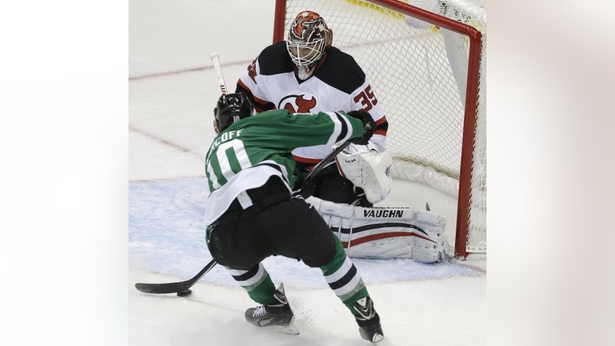 Dallas Stars center Shawn Horcoff (10) closes in on his way to scoring a goal against New Jersey Devils goalie Cory Schneider (35) during the second period of an NHL hockey game Saturday, Dec. 13, 2014, in Dallas. (AP Photo/LM Otero)