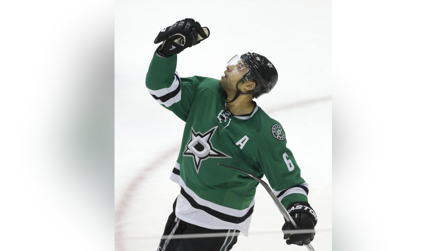Dallas Stars' Trevor Daley celebrates scoring a goals during the second period of an NHL hockey game against the New Jersey Devils, Saturday, Dec. 13, 2014, in Dallas. (AP Photo/LM Otero)