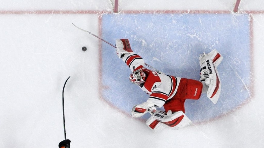 Philadelphia Flyers' Michael Raffl, of Austria, scores a goal past Carolina Hurricanes' Anton Khudobin, of Kazakstan, during the second period of an NHL hockey game, Saturday, Dec. 13, 2014, in Philadelphia. (AP Photo/Matt Slocum)