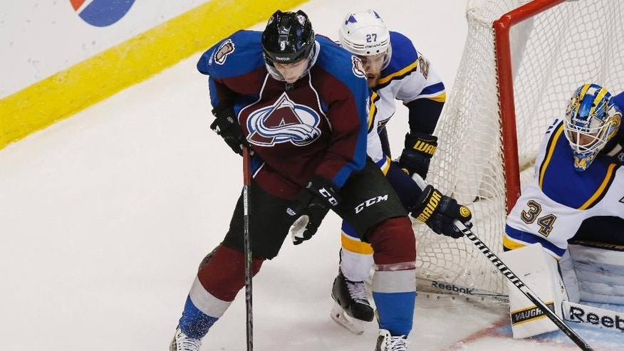 Colorado Avalanche center Matt Duchene, left, tries to move puck inside for a shot as St. Louis Blues defenseman Alex Pietrangelo, center, covers and goalie Jake Allen protects the net in the third period of an NHL hockey game on Saturday, Dec. 13, 2014, in Denver. The Blues won 3-2 in overtime. (AP Photo/David Zalubowski)