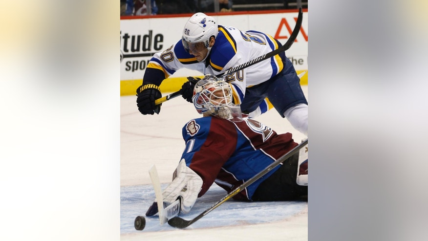Colorado Avalanche goalie Calvin Pickard, front, makes stick save of shot off the stick of St. Louis Blues left wing Alexander Steen in the second period of an NHL hockey game on Saturday, Dec. 13, 2014, in Denver. (AP Photo/David Zalubowski)